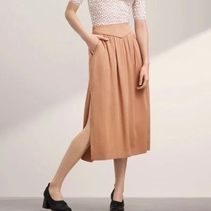 Wilfred Aritzia Gabrielle Skirt High Waisted Side Slits with Two Pockets in Tan